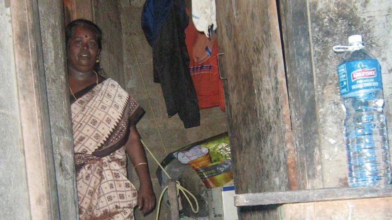 Shylaja inside her house damaged by floods in Kanakassery settlement.
