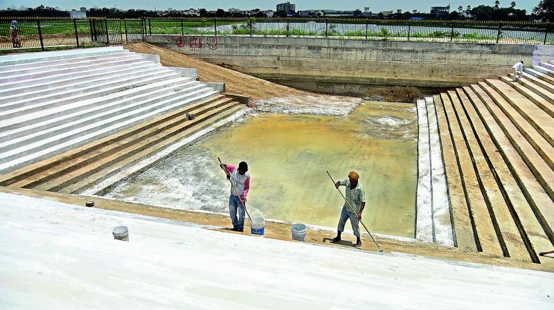 Ponds being cleaned up for Ganesh  immersion at Kapra lake.(Photo: S. Surender Reddy)