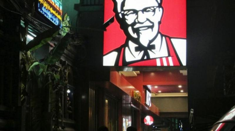 A sign of KFC's grinning Colonel Sanders and his goatee is lit outside its outlet in Yangon, Myanmar. (Photo: AP)