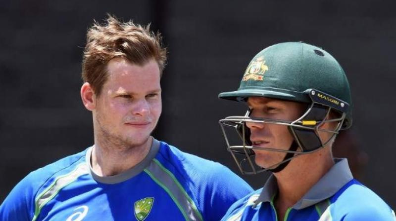 Steve Smith and David Warner completed their full return when Australia recalled them to a 14-man Twenty20 squad to play Sri Lanka and Pakistan with a firm eye on next year's World Cup. (Photo: AFP)