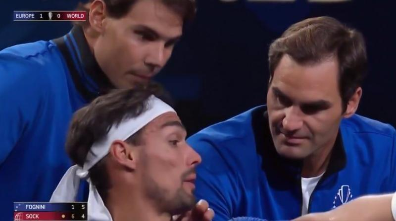 Although the Italian went on to lose the match 6-1, 7-6, what made the match memorable was Roger Federer and Rafael Nadal combining to hand out tips to Fognini. (Photo: Twitter/ Laver Cup)