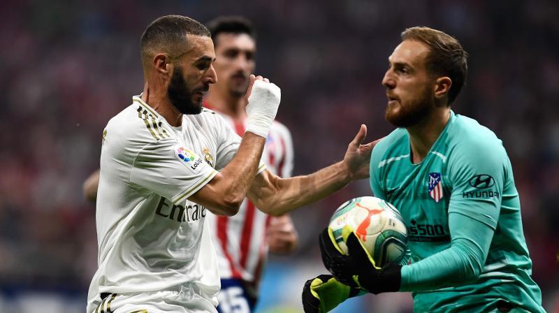 Karim Benzema came closest to scoring at the Wanda Metropolitano but Atletico goalkeeper Jan Oblak made a fine save. (Photo: AFP)