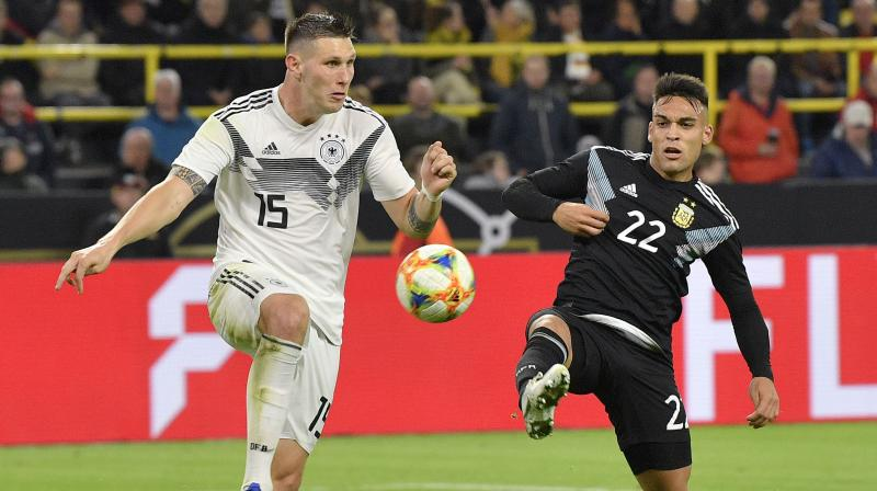 Injury-decimated Germany squandered a two-goal lead to draw 2-2 with Argentina thanks to Lucas Ocampos's 85th-minute equaliser in a friendly on Wednesday. (Photo: AP)