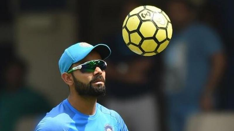 Virat Kohli is known for being an ardent football fan. Before the ICC World Cup this year, he met England and Tottenham Hotspur star, Harry Kane. (Photo: AFP)