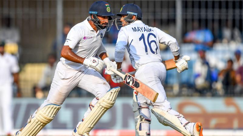Pujara and Mayank put up a 72 run partnership. (Photo: AFP)