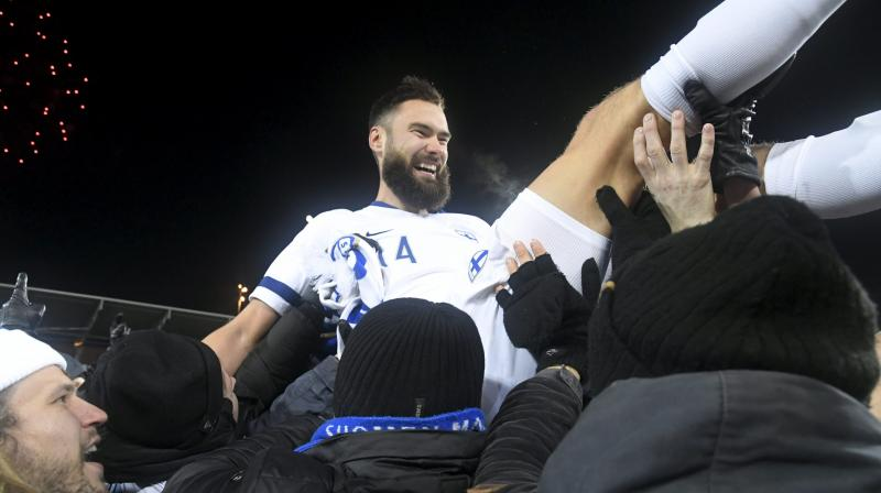 Finnish captain Tim Sparv celebrates with fans after qualifiying for Euro 2020. Finland registered a 3-0 defeat and as a result, now the side will be making their debut in a final tournament. (Photo: AFP)