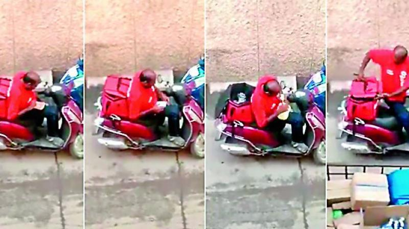 The video of the Zomato delivery personnel spotted eating from a food parcel, assumed to be of a customer.