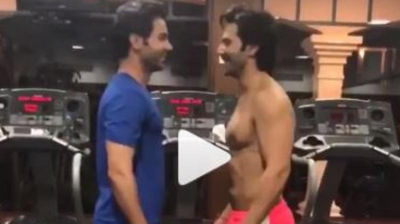 Screenshot from video of Varun Dhawan and Rajkummar Rao at the gym.