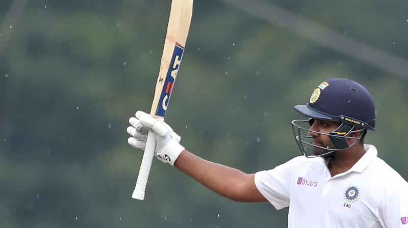 Opening batsman Rohit Sharma smashed a ton and broke the record for registering the most number of sixes in a bilateral Test series. (Photo: AP)