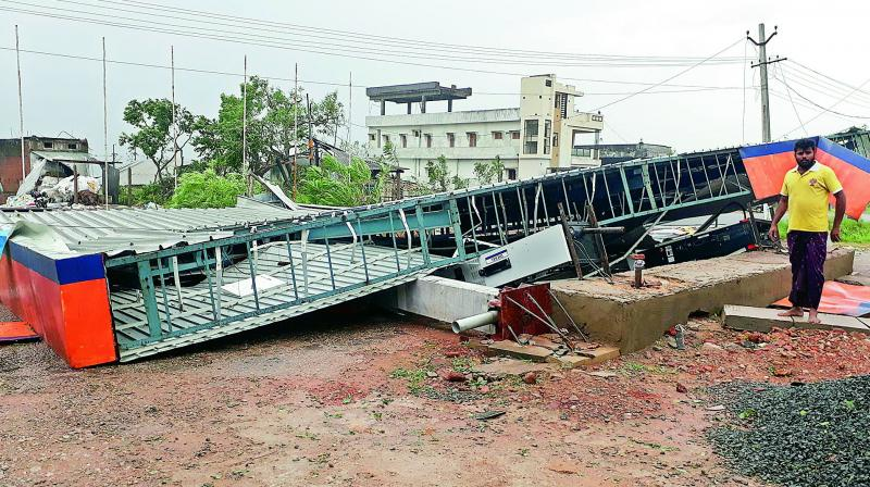 The roof of a petrol bunk collapses due to the devastation caused by the cyclone Titli at Kanchili in Srikakulam district on Thursday.(Photo: Murali Krishna)