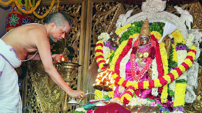 A priest offers kumbha harati to an idol of Goddess Kankadurga atop Indrakeeladri in Vijayawada on Thursday.