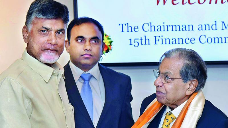 Chief Minister N. Chandrababu Naidu felicitates 15th Finance Commission chairman N.K. Singh at the Secretariat on Thursday (Photo: DC)