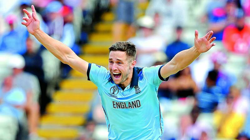 England fast bowler Chris Woakes appeals during the second semifinal against Australia at Edgbaston in Birmingham on Thursday. (Photo: AFP)