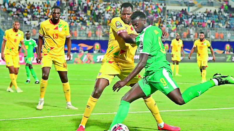 Action between Senegal (green) and Benin in the Africa Cup of Nations quarterfinals in Cairo on Thursday. (Photo: AFP)