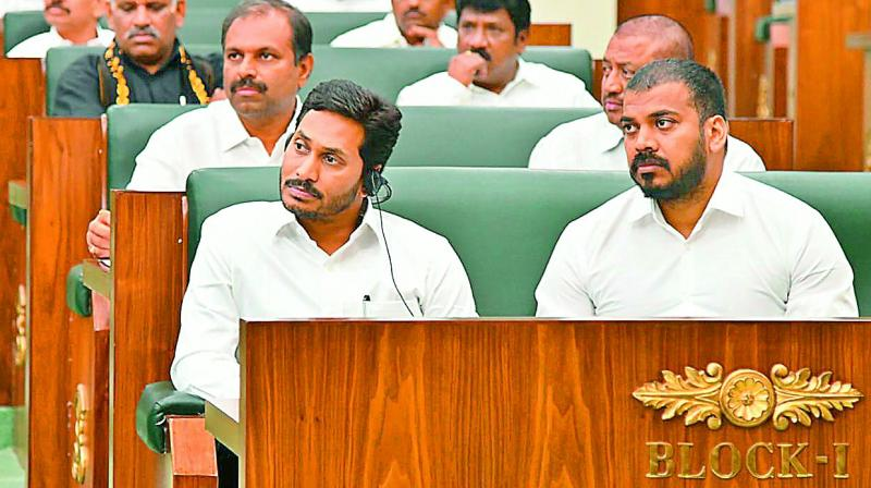 Chief Minister Y.S. Jagan Mohan Reddy, minister Anilkumar Yadav in the Assembly Hall on Thursday. (Photo: DC)