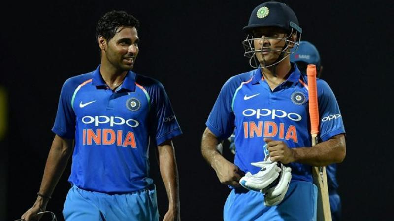 """If you look at his (MS Dhoni's) record, nobody (the team management) is really bothered. Whatever he has done, he has been doing well, he knows he is a legend. Whatever he is doing, it is benefitting the Indian team,"" said Bhuvneshwar Kumar. (Photo: PTI)"