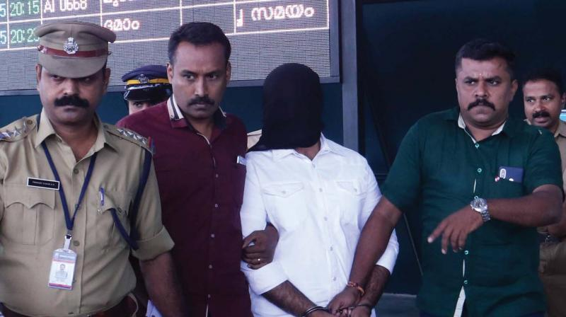 Police brings Mohammed Salih alias Ali Bhai out of Thiruvananthapuram airport on Tuesday. 	—DC