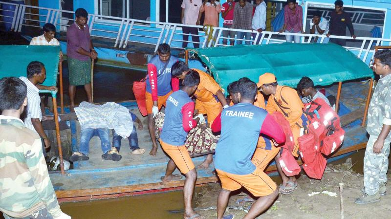 APSDRF personnel carry out a search and rescue operation after a boat carrying around 60 people capsized in the swollen Godavari river in East Godavari district of Andhra Pradesh Sunday afternoon (Photo: PTI)