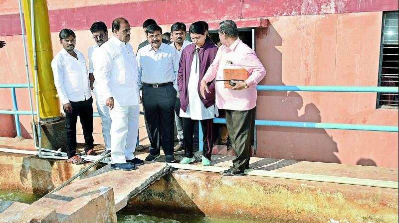Collector S. Satyanarayana, legislator A. Venkatrami Reddy and other offficials inspect water purification plant at Muddalapuram in Anantapur on Sunday.