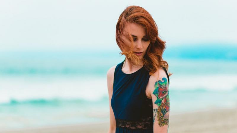 Study claims having a tattoo can land you a job. (Photo: Pexels)