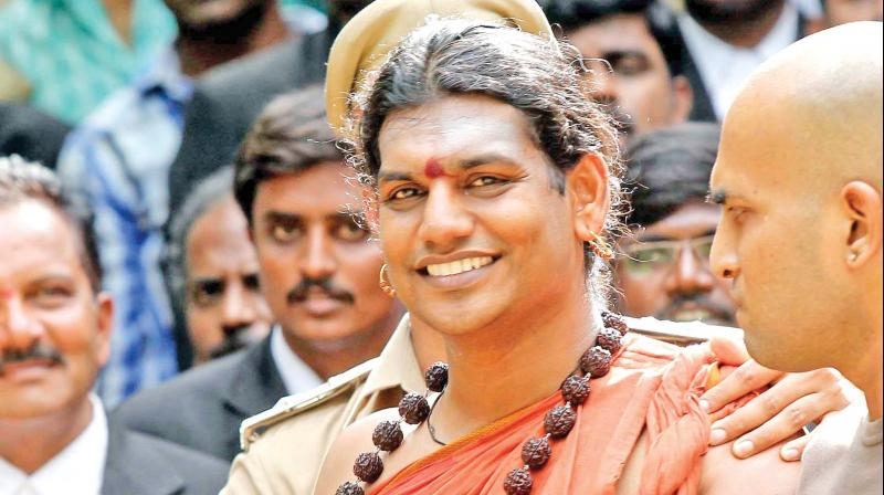 Self-styled godman Swami Nithyananda, booked in a criminal case related to his ashram here, has fled the country, with the Gujarat police working to gather concrete evidence against him after taking two of his disciples in remand, officials said on Thursday. (Photo: File)