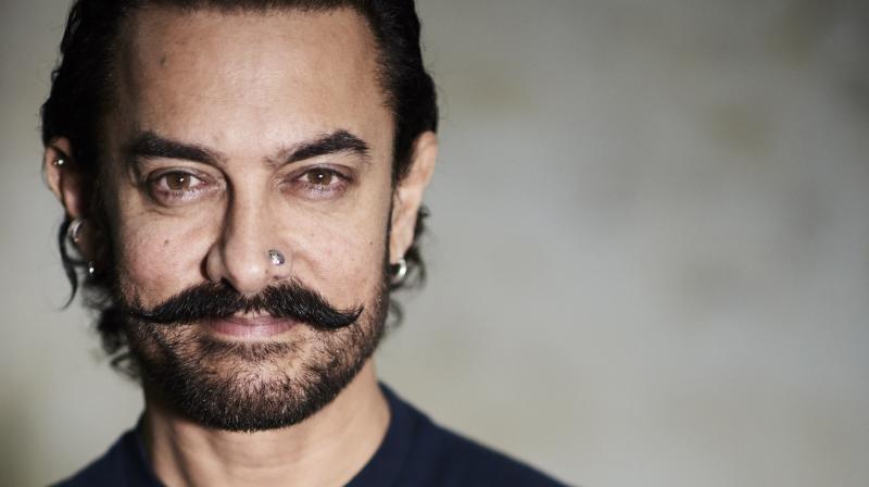Watch: Aamir Khan amazes co-passengers by flying in economy class