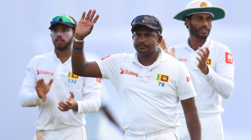 Last man out was silver fox Rangana Herath, cricket's most successful left-arm spinner in history, in his last match before retirement. (Photo: AFP)