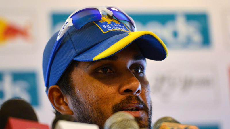 Dinesh Chandimal didn't field during England's second innings on Thursday, and batted in pain for scores of 33 and 1. (Photo: AFP)
