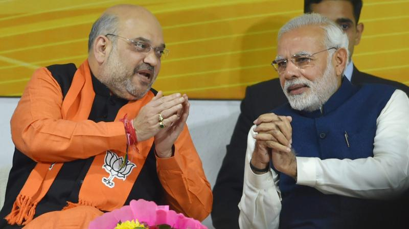 Prime Minister Narendra Modi and BJP President Amit Shah at a felicitation function before the party's parliamentary board meeting in New Delhi on Monday, after the party's win in Gujarat and Himachal Pradesh Assembly elections. (Photo: PTI)