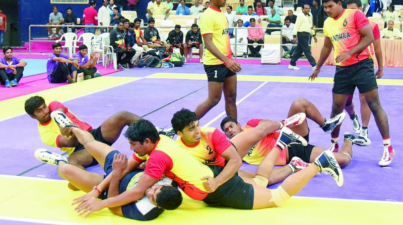 Andhra Pradesh players pin down their rival from Chhattisgarh on way to a 44-43 victory.