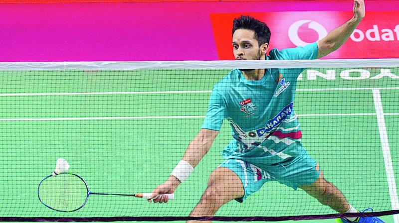 Awadhe Warriors' Parupalli Kashyap in action in their PBL match against Sourabh Verma of Ahmedabad Smash Masters in Lucknow on Tuesday. Kashyap won 11-15, 15-13, 15-14.