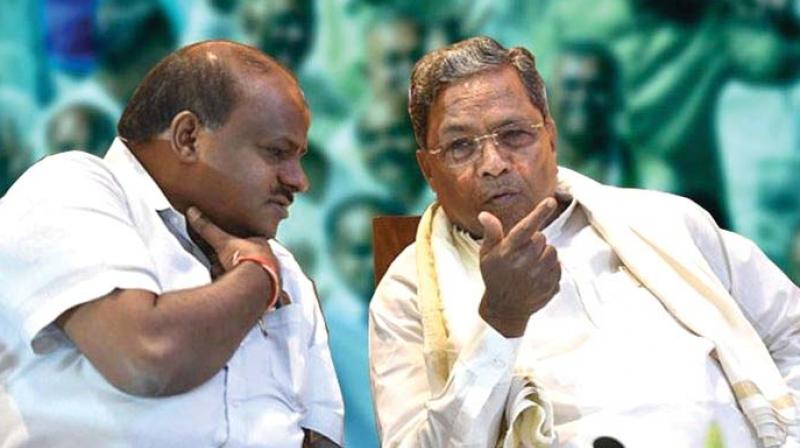 Former chief ministers H.D. Kumaraswamy and Siddaramaiah in happier times