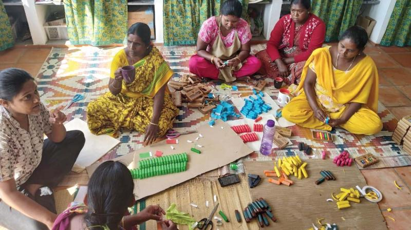 Adivasi women, working with NGO Hoopoe on a Hill, make bees wax crayons and wraps at Kodaikanal
