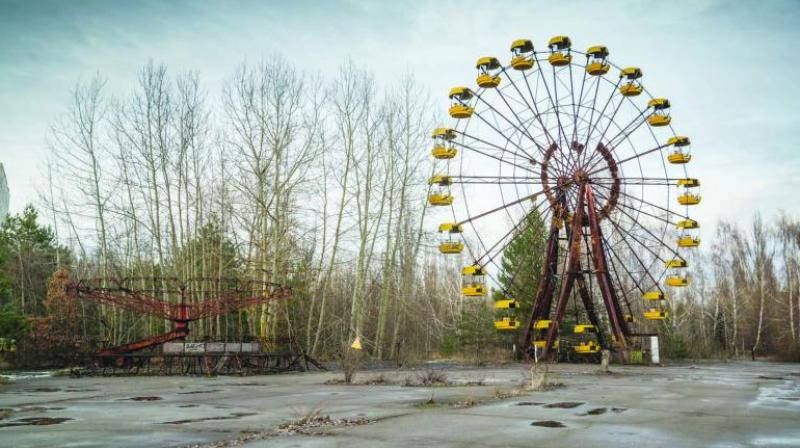 The image of an abandoned giant wheel in the premises of Chernobyl Nuclear Power Plant.