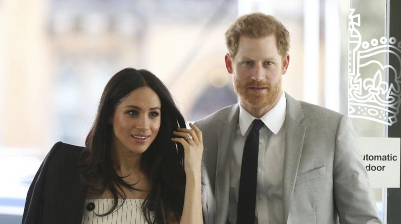 Britain's Prince Harry and Meghan Markle attend a reception for the Commonwealth Youth Forum at the Queen Elizabeth II Conference Centre, London, during the Commonwealth Heads of Government Meeting, Wednesday April 18, 2018. (Photo: AP)