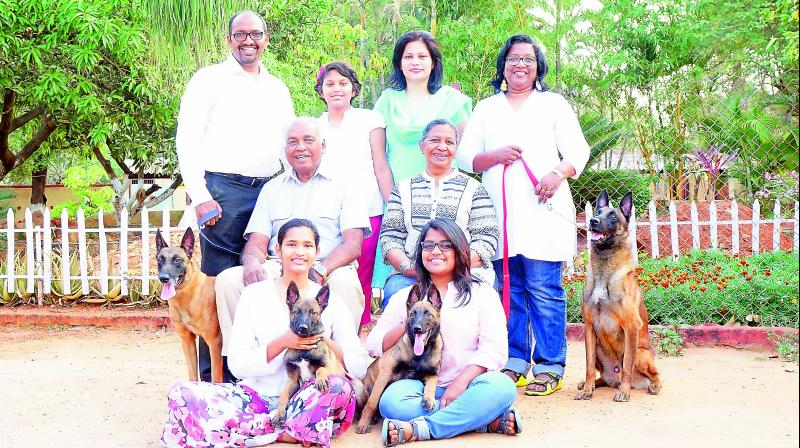 Pet lovers pose with their beloved canines.