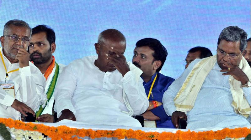 Minister G.T. Deve Gowda, JD(S) supremo H.D. Deve Gowda and coordination committee chairman Siddaramaiah during an election rally addressed by AICC president Rahul Gandhi at the Government PU College Ground in KR Nagar on Saturday. (Image KPN)