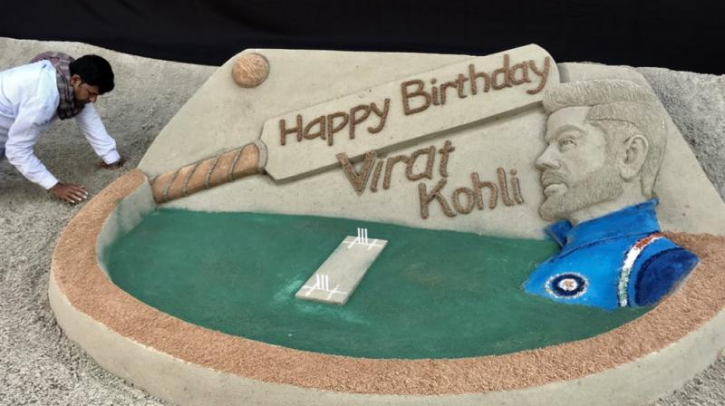 Noted sand artist Sudarsan Pattnaik Monday made a cricket-themed sand art installation here to wish ace batsman Virat Kohli on his 30th birthday. (Photo: Twitter / Sudarsan Pattnaik)