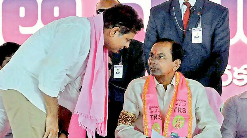 father, son and the centre stage: Telangana Rashtra Samiti president and Chief Minister K. Chandrasekhar Rao (right) along with his son K.T. Rama Rao during one of the election rallies. The TRS party was formed with the sole aim carving out a separate Telangana state. Now, Mr Chandrasekhar Rao has set his eyes on national politics.