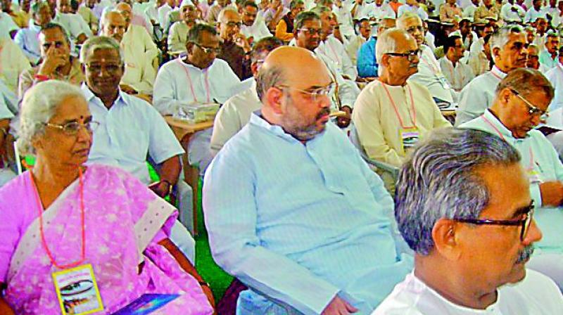 BJP president Amit Shah sitting almost anonymously in the audience at an RSS conclave in Lucknow. Mr Shah's deference for the ideological fountainhead underscores the importance of the swayamsevaks for the party's victory.