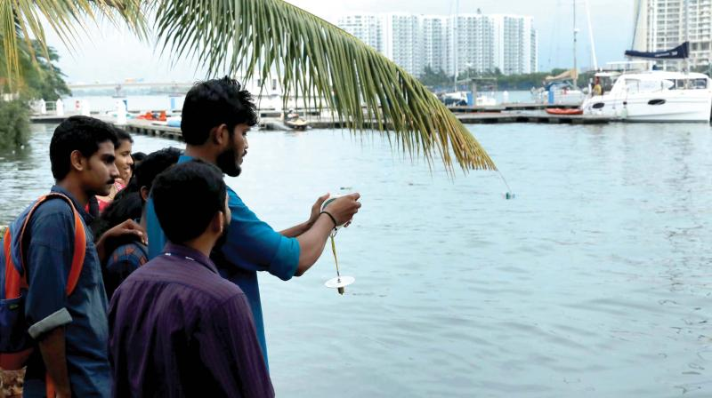 College students and environmentalists participate in a study launched to investigate the pollution levels in Vembanad Lake in Kochi on Monday (Photo: DC)