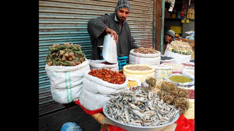A vendor selling dried vegetables, fish and herbs which form an integral part of the Kashmiri cuisine, especially during the extreme winter. (Photo: Rising Kashmir)