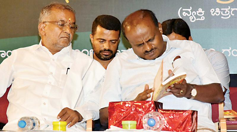 Chief Minister H.D. Kumaraswamy with minister G.T. Devegowda in this file photo 	(Image KPN)