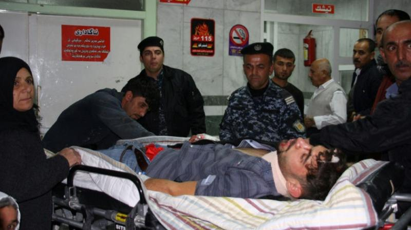 An earthquake victim is aided at Sulaimaniyah Hospital in Iraq. (Photo: AFP)