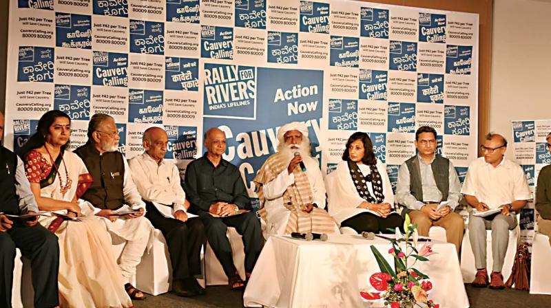 Isha Foundation founder Sadhguru Jaggi Vasudev(Middle) addressing a press conference on Rally for Rivers  in the city on Saturday. (From left)  Ravi Singh, World Wild Life Fund, CEO, Suhasini Maniratnam, actor, former ISRO chairmen Dr K. Radhakrishnan and Kiran Kumar, Justice Arijit Pasayat, former Supreme Court Judge, Kiran Mazumdar-Shaw, CMD, Biocon, Pravesh Sharma, former bureaucrat Narasimha Raju, former state principal secretary and Yuri Jain, Coordinator, Rally For Rivers.  (R.Samuel)