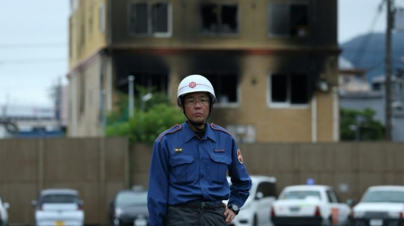 The investigation into the deadly fire was being complicated by thea fact that the chief suspect, a 41-year-old man detained on Thursday, suffered serious burns in the blaze and was in hospital. (Photo: AFP)