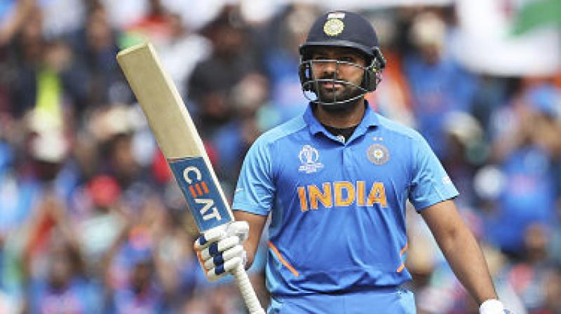Star Indian batsman Rohit Sharma on Saturday became the first batsman to score five hundreds in a single World Cup, 103 against Sri Lanka, eclipsing former Lankan captain Kumar Sangakkara's record. (Photo:AFP)