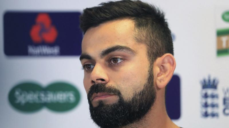 Photographs of Indian players including Virat Kohli, Suresh Raina, Rohit Sharma and L. Balaji have appeared with ICC's most wanted man Aneel Munawar in the latest documentary released by the Doha-based Al Jazeera. (Photo: AP)