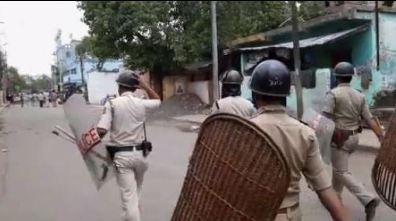 A team of police officers along with Rapid Action Force (RAF) personnel has been deployed in the area, with shops, market places and business establishments seen downing shutters following the unrest. (Photo: ANI)