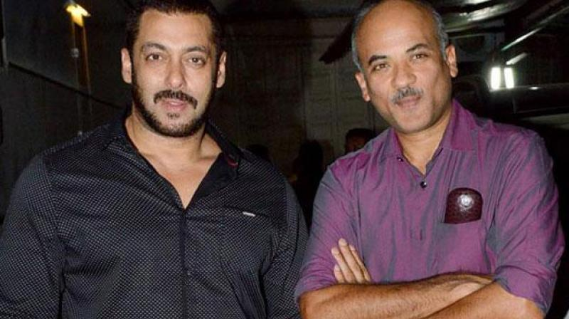 Salman Khan and Sooraj Barjatya at an event.